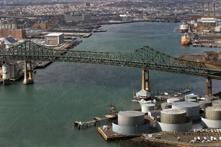 Chelsea oil tanks on the right, with ships on the docks in Everett, upper right. The Tobin Bridge spans the river and Charles