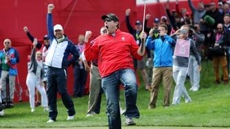 CHASKA, MN - SEPTEMBER 29: Fan David Johnson of North Dakota reacts after being pulled from the crowd and making a putt on the eighth green during practice prior to the 2016 Ryder Cup at Hazeltine National Golf Club on September 29, 2016 in Chaska, Minnesota.  (Photo by David Cannon/Getty Images)
