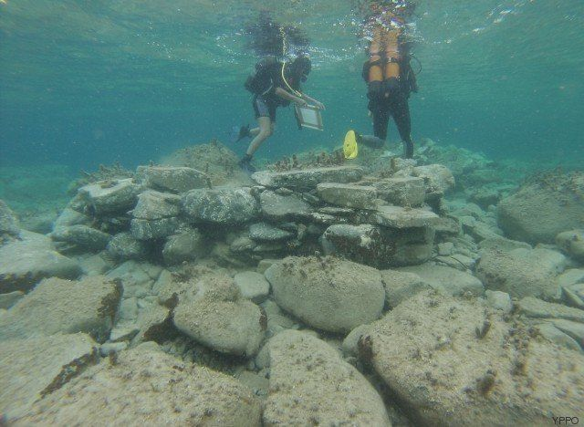 Divers inspect relics off the Greek island of Delos.