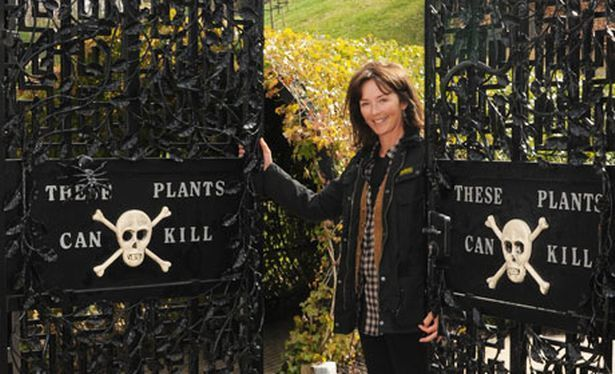 The Duchess of Northumberland at the gates of her Poison Garden at Alnwick Garden, England.