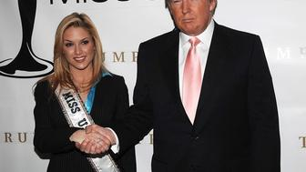 NEW YORK - DECEMBER 19: Donald Trump (L) and Miss USA Tara Conner pose during press conference at Trump Tower on December 19, 2006 in New York City.  Developer Donald Trump, who owns the Miss USA Pagent, decided not to recind Conner's Miss USA title over alligations of underage drinking and other conduct forbidden to Miss America winners.   (Photo by Brad Barket /Getty Images)