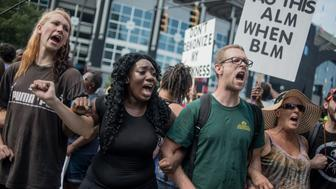 CHARLOTTE, NC - SEPTEMBER 25: Demonstrators protest outside of Bank of America Stadium before an NFL football game between the Charlotte Panthers and the Minnesota Vikings September 25, 2016 in Charlotte, North Carolina. Protests have disrupted the city since Tuesday night following the shooting of 43-year-old Keith Lamont Scott at an apartment complex near UNC Charlotte. (Photo by Sean Rayford/Getty Images)