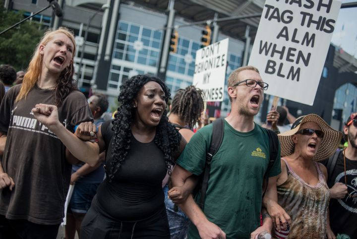 Demonstrators protest outside of Bank of America Stadium before an NFL football game between the Charlotte Panthers and the M
