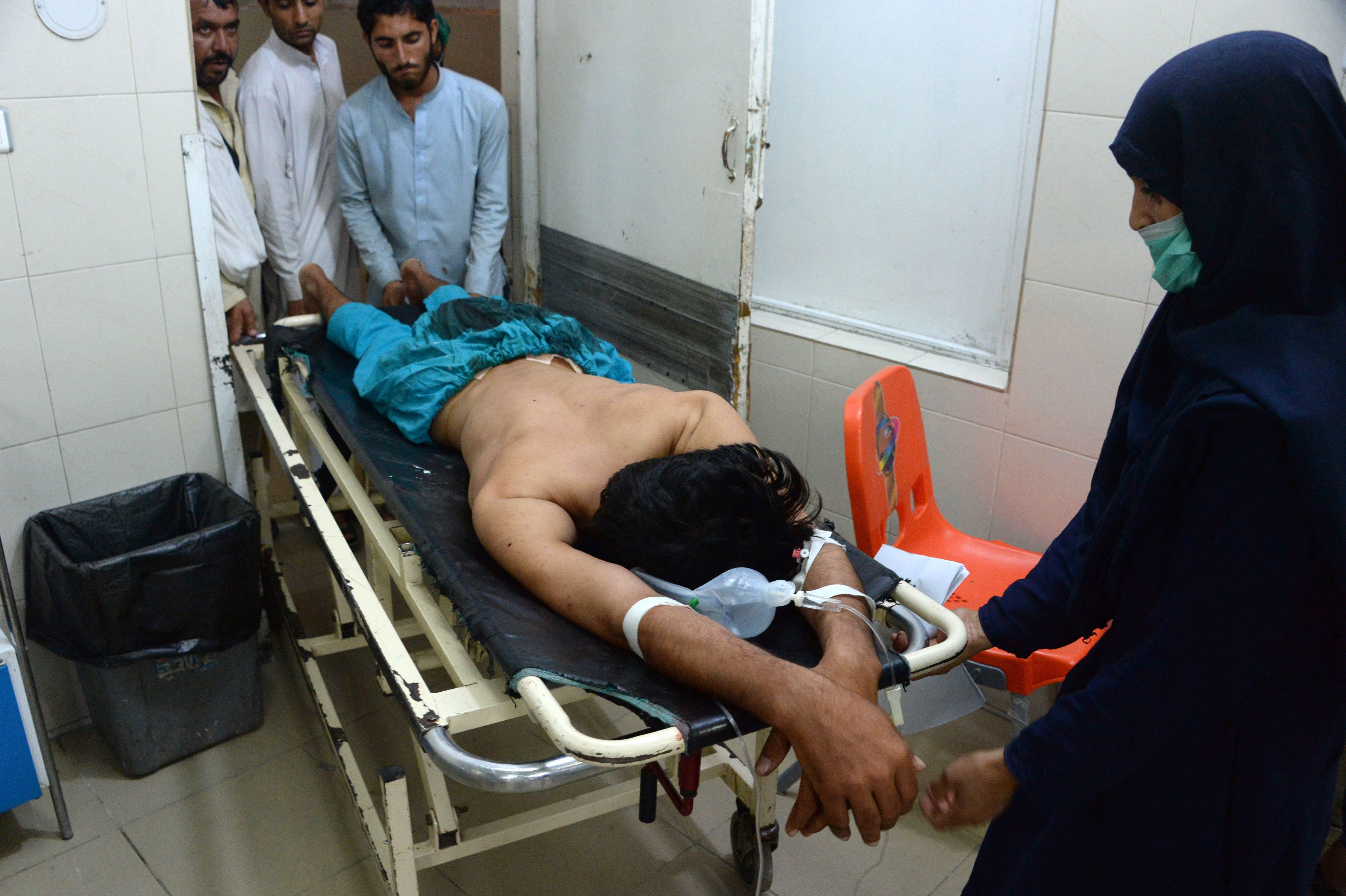 An injured Afghan youth receives treatment at a hospital following a suspected US drone airstrike in the Achin district of Nangarhar province on September 28,2016.   A suspected US drone strike has killed 18 people in the restive eastern province of Nangarhar, with some Afghan sources claiming some of the fatalities were Afghan civilians. / AFP / NOORULLAH SHIRZADA        (Photo credit should read NOORULLAH SHIRZADA/AFP/Getty Images)
