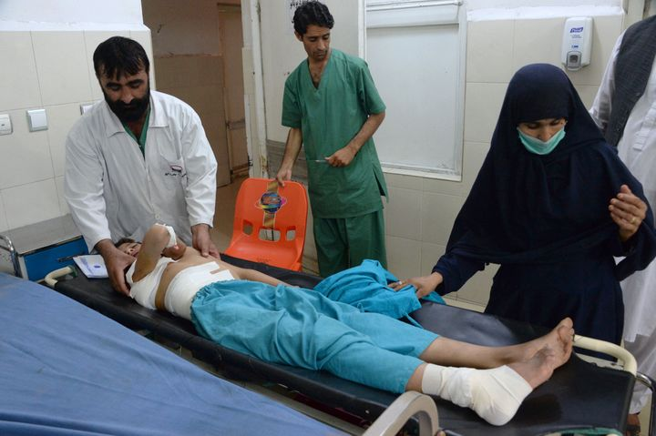 An injured Afghan youth receives treatment at a hospital following a suspected US drone airstrike in the Achin district of Na