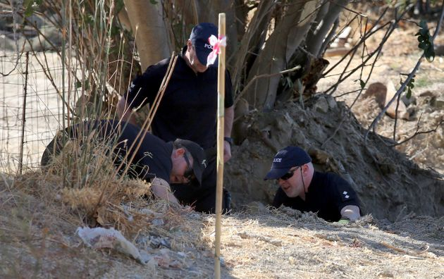 Detective Inspector Jon Cousins (right) of South Yorkshire Police in Kos, Greece, as officers from South...
