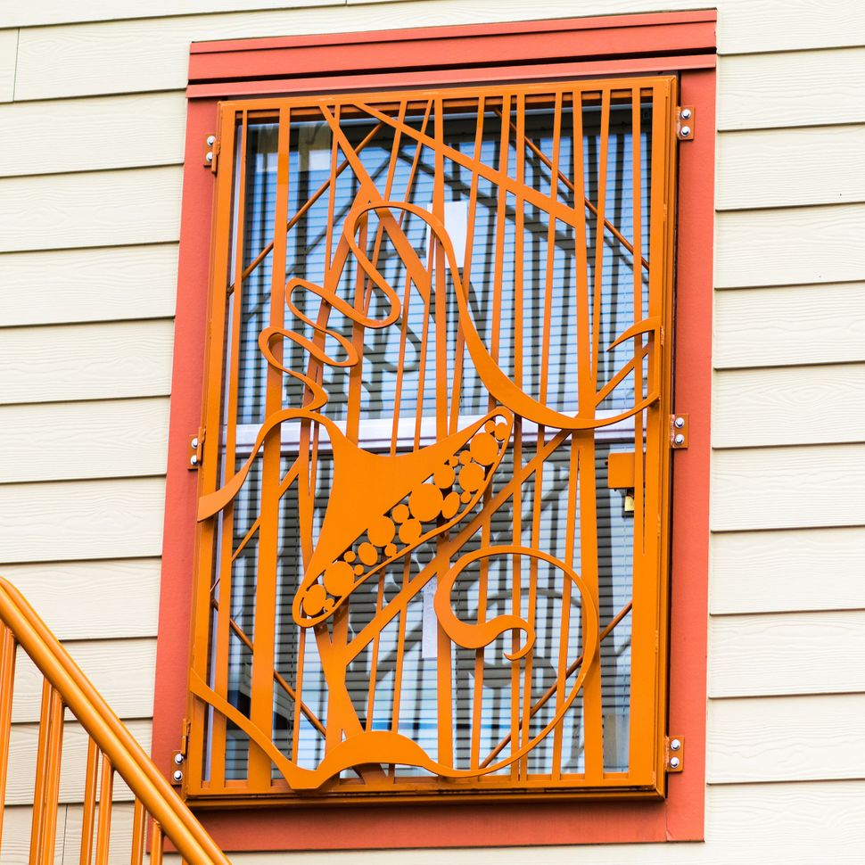These emergency shelter security window grilles were designed and fabricated by architect Jennifer Weddermann for YWCA P