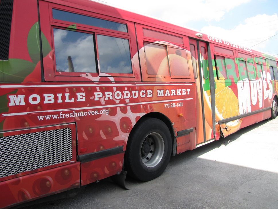 One of the early Fresh Moves mobile farmer's markets, installed in a decommissioned public bus.