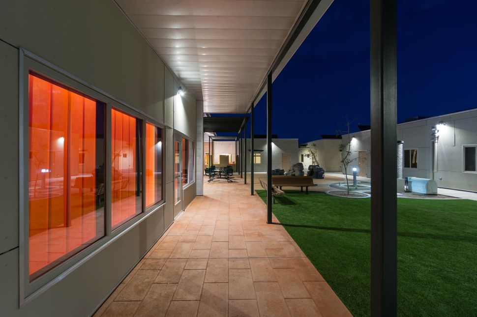 A sheltered patio in the Las Abuelitas Kinship Housing development in South Tucson, Arizona, protects the residents from the
