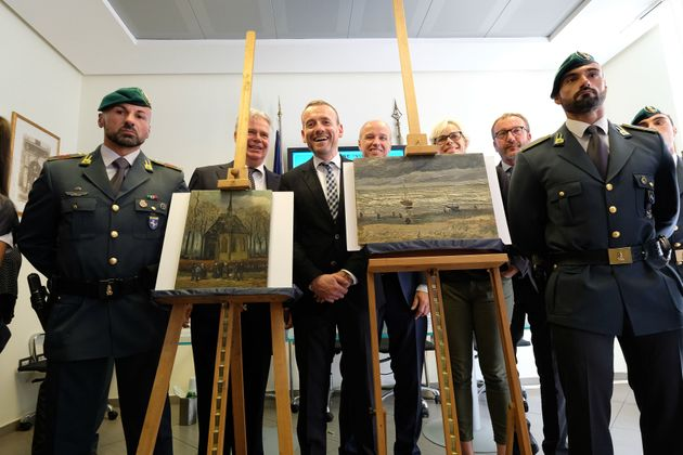 Axel Ruger (C), Director of the Van Gogh museum poses next to the recovered