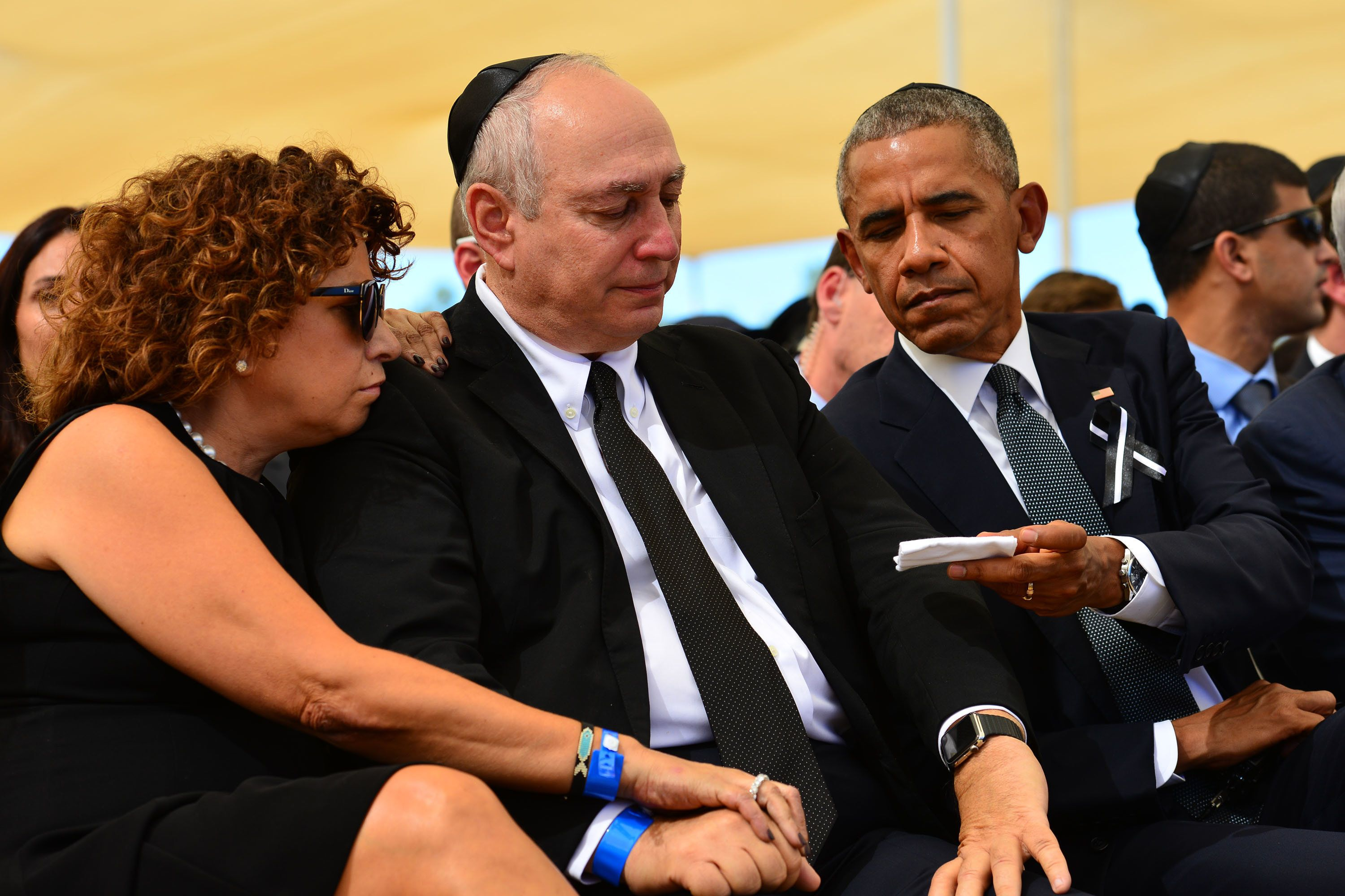 President Barack Obama sitting next toChemi Peres at Peres' father's funeral.