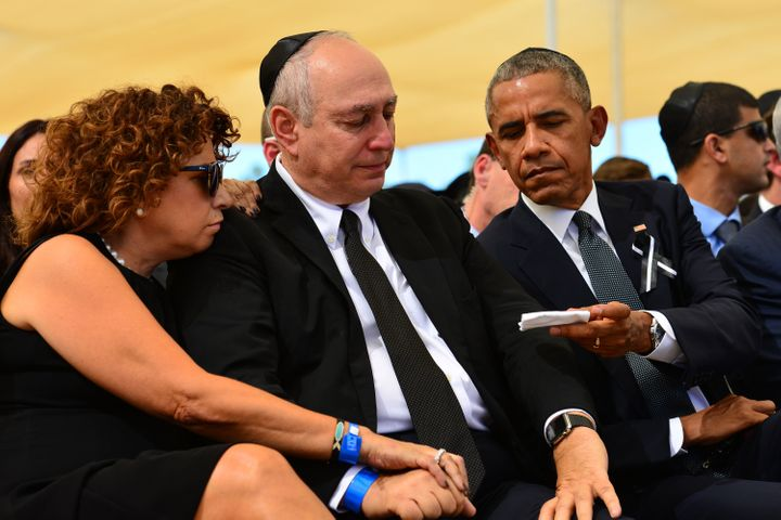 President Barack Obama sitting next to Chemi Peres at Peres' father's funeral.