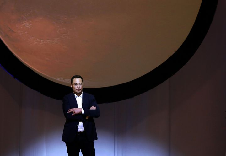 Elon Musk, chief executive officer for Space Exploration Technologies Corp. (SpaceX), pauses while speaking during the 67th I