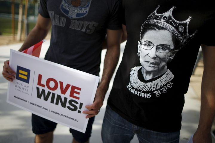 """A man wears a T-shirt showing U.S. Supreme Court Justice Ruth Bader Ginsburg as """"Notorious R.B.G."""" at a celebration rally in"""