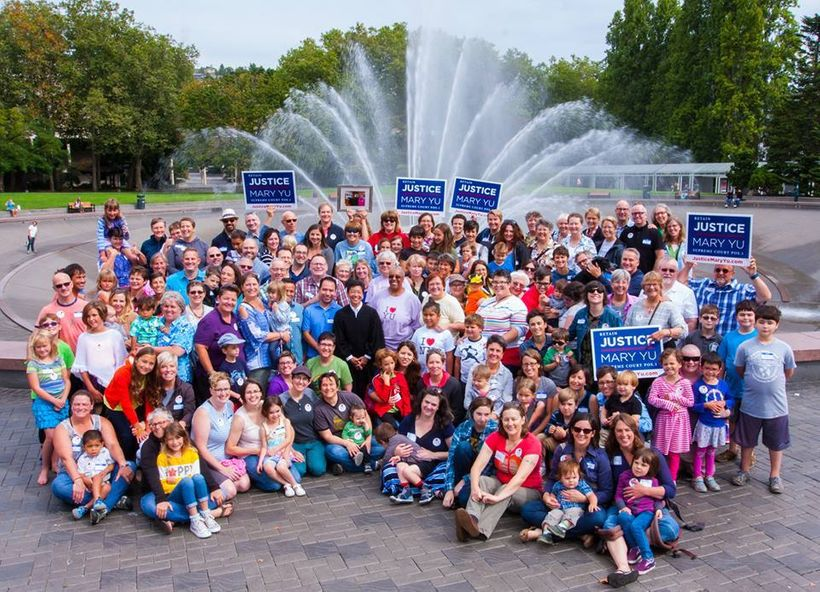Families united at the Seattle Center Fountain to take a once-in-a-lifetime group family photo