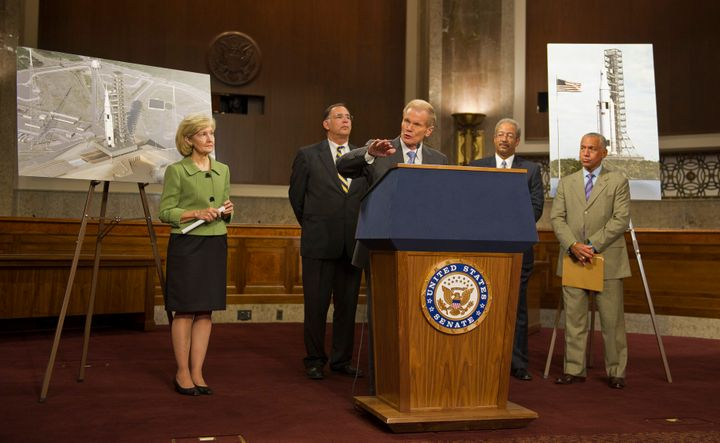 Members of Congress and NASA Administrator Charles Bolden unveil the Space Launch System design in September 2011. From left: