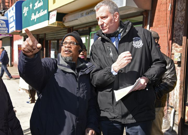 Mayor Bill de Blasio speaks with social worker Irwin Jeffrey, who expressed concern over gentrification and and the risi
