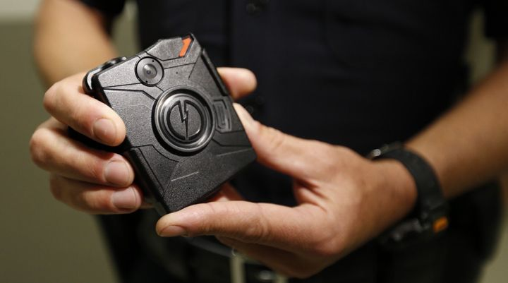 Los Angeles Police Department Officer Jim Stover demonstrates the use of a body camera during a training session at Mission S