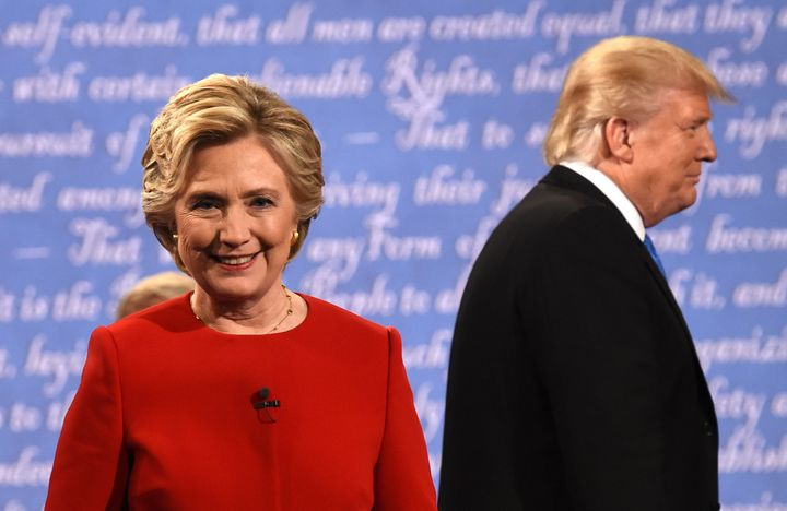 Democratic nominee Hillary Clinton (L) and Republican nominee Donald Trump leave the stage after the first presidential debat