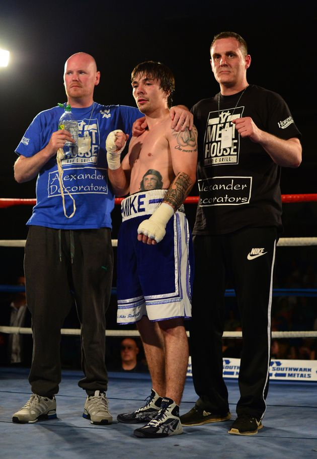 Towell [centre] after beating Danny Little in