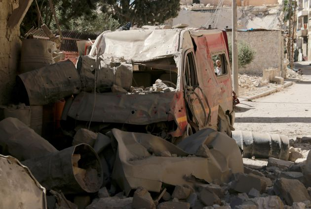 A destroyed ambulance is seen after a barrel bomb strike by Syrian regime forces over Sahra Hospital...