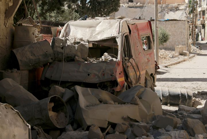 A destroyed ambulance is seen after a barrel bomb strike by Syrian regime forces over Sahra Hospital in Sahur neighborhood of