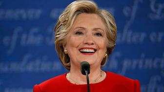 Democratic U.S. presidential nominee Hillary Clinton smiles during the first presidential debate with Republican U.S. presidential nominee Donald Trump at Hofstra University in Hempstead, New York, U.S., September 26, 2016.   REUTERS/Brian Snyder