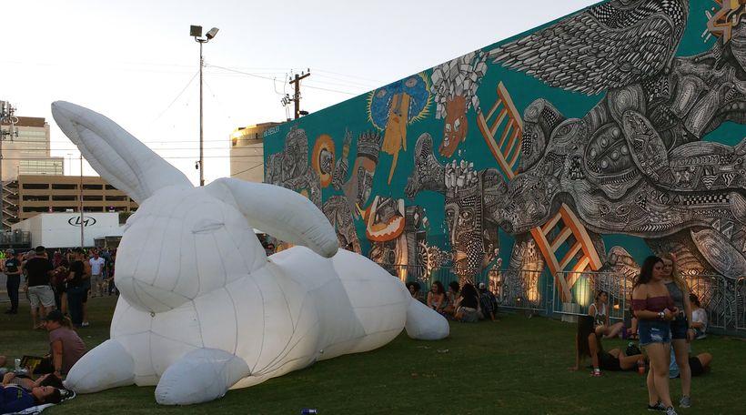 An Amander Parer rabbit makes itself at home beside a Zio Ziegler mural.