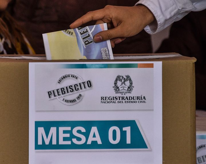 A Colombian citizen casts his vote during a referendum on whether to ratify a historic peace accord to end a 52-year war.