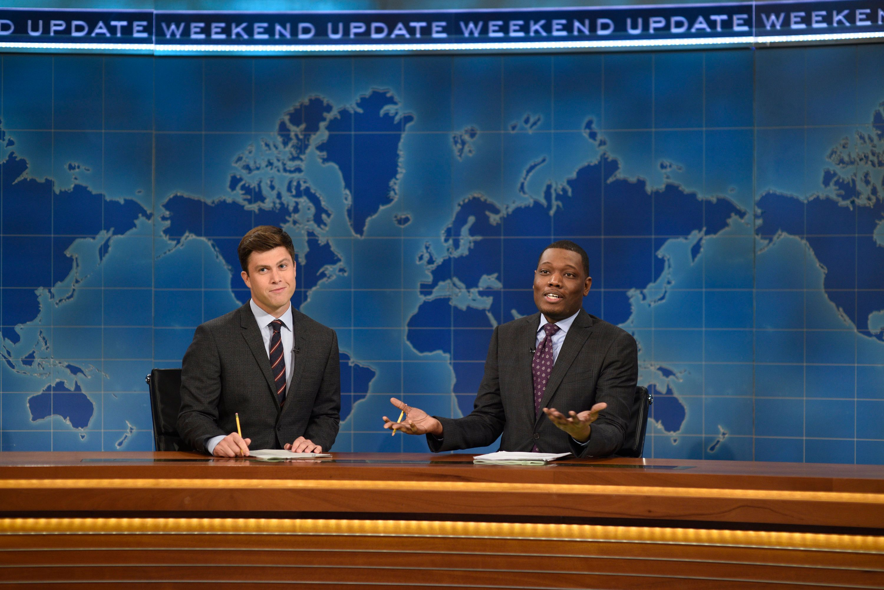 SATURDAY NIGHT LIVE -- 'Margot Robbie' Episode 1705 -- Pictured: (l-r) Colin Jost and Michael Che during Weekend Update on October 1, 2016 -- (Photo by: Will Heath/NBC/NBCU Photo Bank via Getty Images)