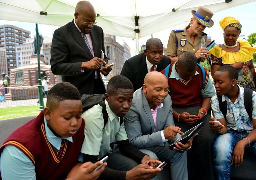 July 2016: Tshwane , South Africa Former Executive Mayor Kgosientso Ramokgopa, surrounded by school pupils  and officials, sa