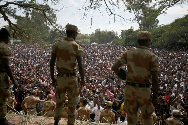 Police officers watch as demonstrators in Bishoftu town, Oromia region, Ethiopia, October 2,