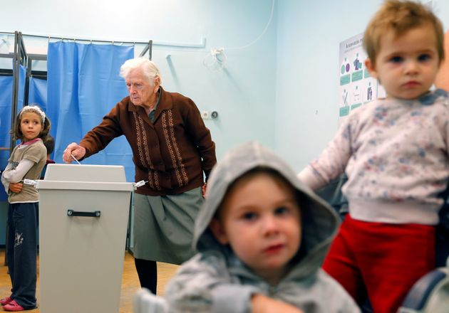 Hungarians vote in a referendum on the European Union's migrant quotas in the village of Roszke near...