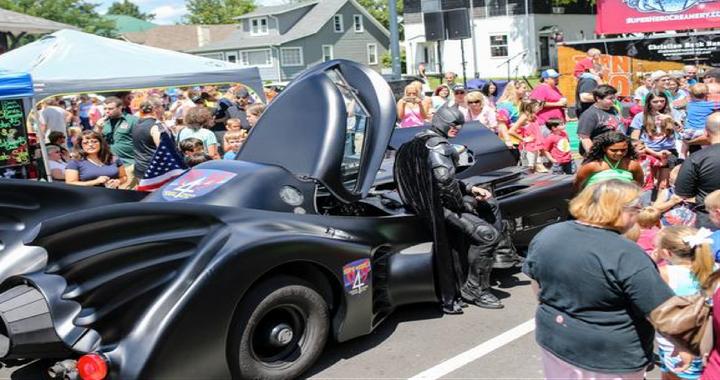 Heroes 4 Higher founder John Buckland is seen dressed as Batman with his Batmobile.