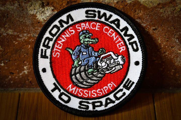 A gift shop at Stennis Space Center in southern Mississippi sells patches showing an alligator sitting atop an RS-25 space sh