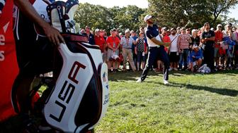 Oct 2, 2016; Chaska, MN, USA;  Dustin Johnson of the United States chips in on the 16th hole during the single matches in 41st Ryder Cup at Hazeltine National Golf Club. Mandatory Credit: Rob Schumacher-USA TODAY Sports