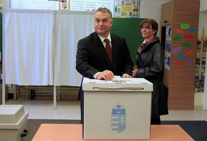 Hungary's Prime Minister Viktor Orban casts his ballot next to his wife Aniko Levai inside a polling station during a referen