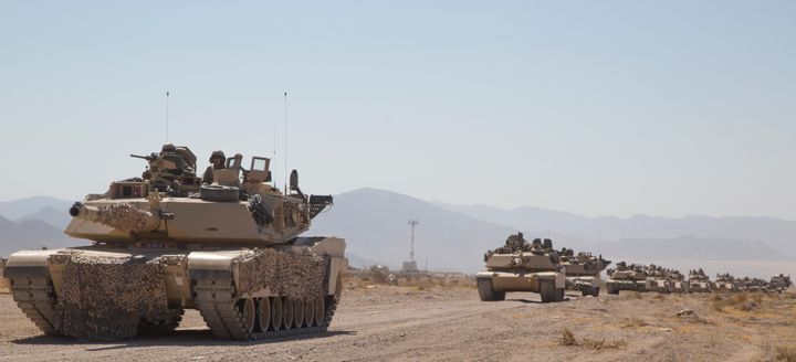 Abrams tanks train in the desert for the possibility of