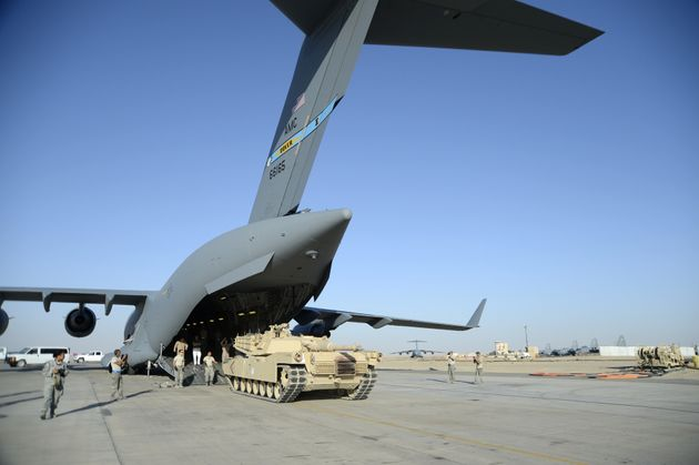An Air Force C-17 unloads an Abrams tank at an undisclosed