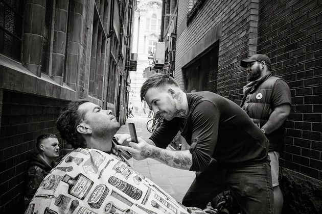 Manchester Barber Gives Free Haircuts To The