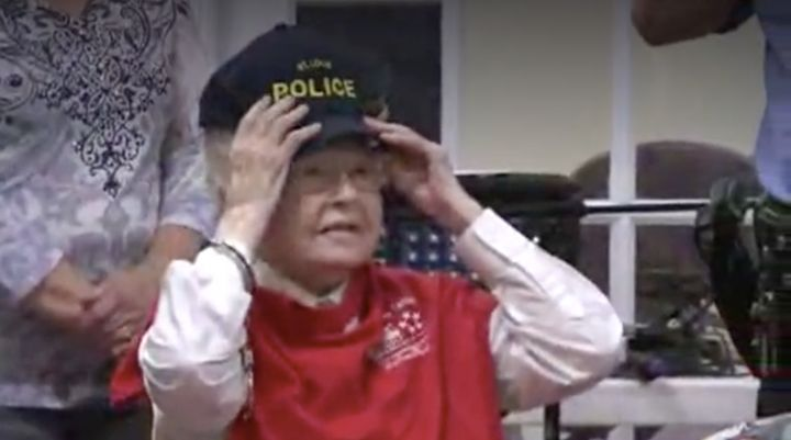 The do-gooder is seen trying on a St Louis Police Department hat after handing out handmade gifts to some of the senior