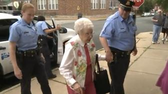 Edie Simms exits a St Louis Police Department cruiser on Friday