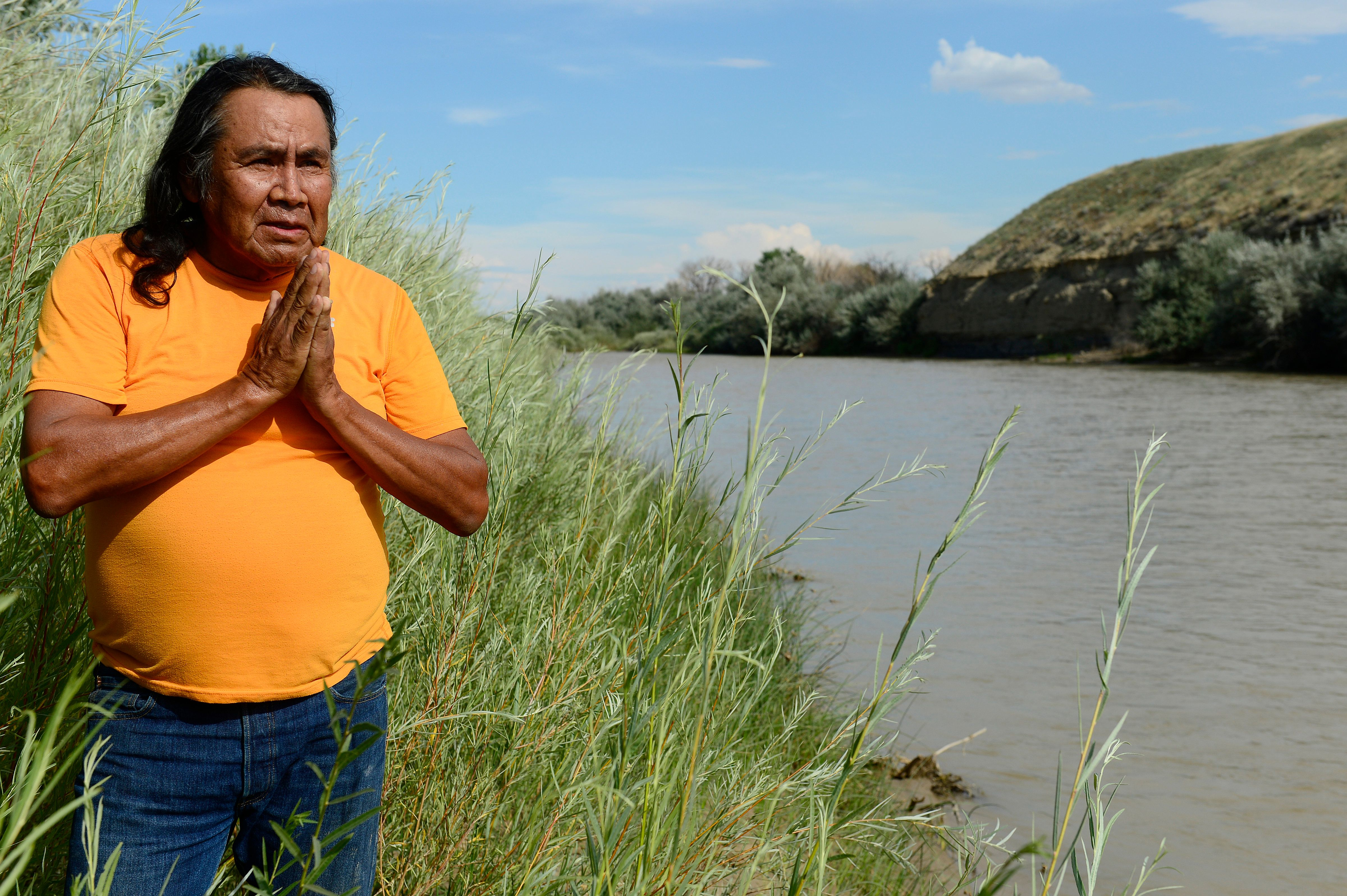 SHIPROCK, NM - AUGUST 15: Roy Etcitty looks out over the San Juan River while reflecting on what the river means to him August 15, 2015. Etcitty, who grew up on the San Juan River, is one of the many farmers that has been affected by the contamination of the San Juan River, causing the water to the Navajo Nation to shut off to farmers and residents who depend on that as their main water source. Close to 20 charters of the Navajo Nation rely on the San Juan River for their farming and raising of livestock needs as well as many relying on the river for drinking water. (Photo By Brent Lewis/The Denver Post via Getty Images)