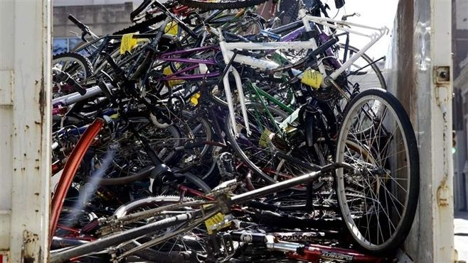 Some cities are turning an eyesore into money by taking abandoned bikes and auctioning them off, while others are giving them