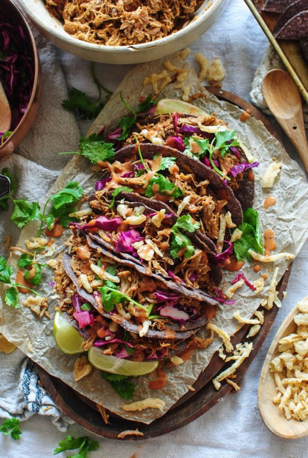 "<strong>Get the <a href=""http://bevcooks.com/2016/09/slow-cooker-pulled-pork-bbq-crunchy-tacos/"" target=""_blank"">Slow Cooked"