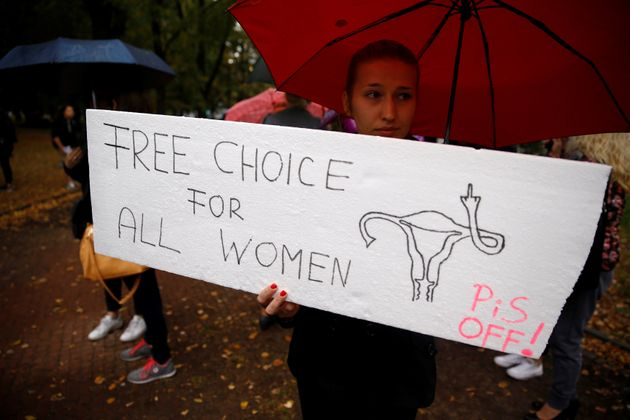 A woman holds a placard in an abortion rights campaigners' demonstration to protest against plans for...