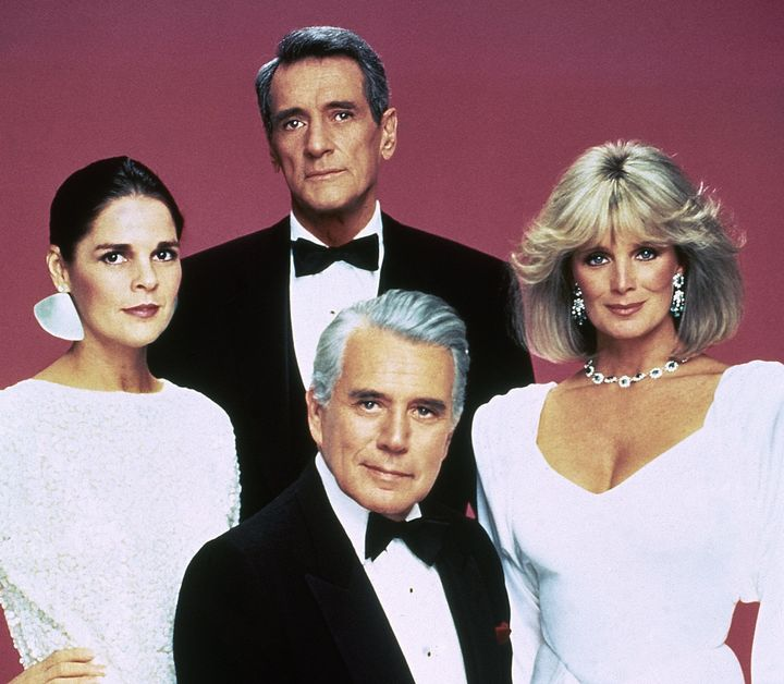"Rock Hudson (center back) poses with fellow ""Dynasty"" cast members John Forsythe, Linda Evans (right) and Ali MacGraw (left)"