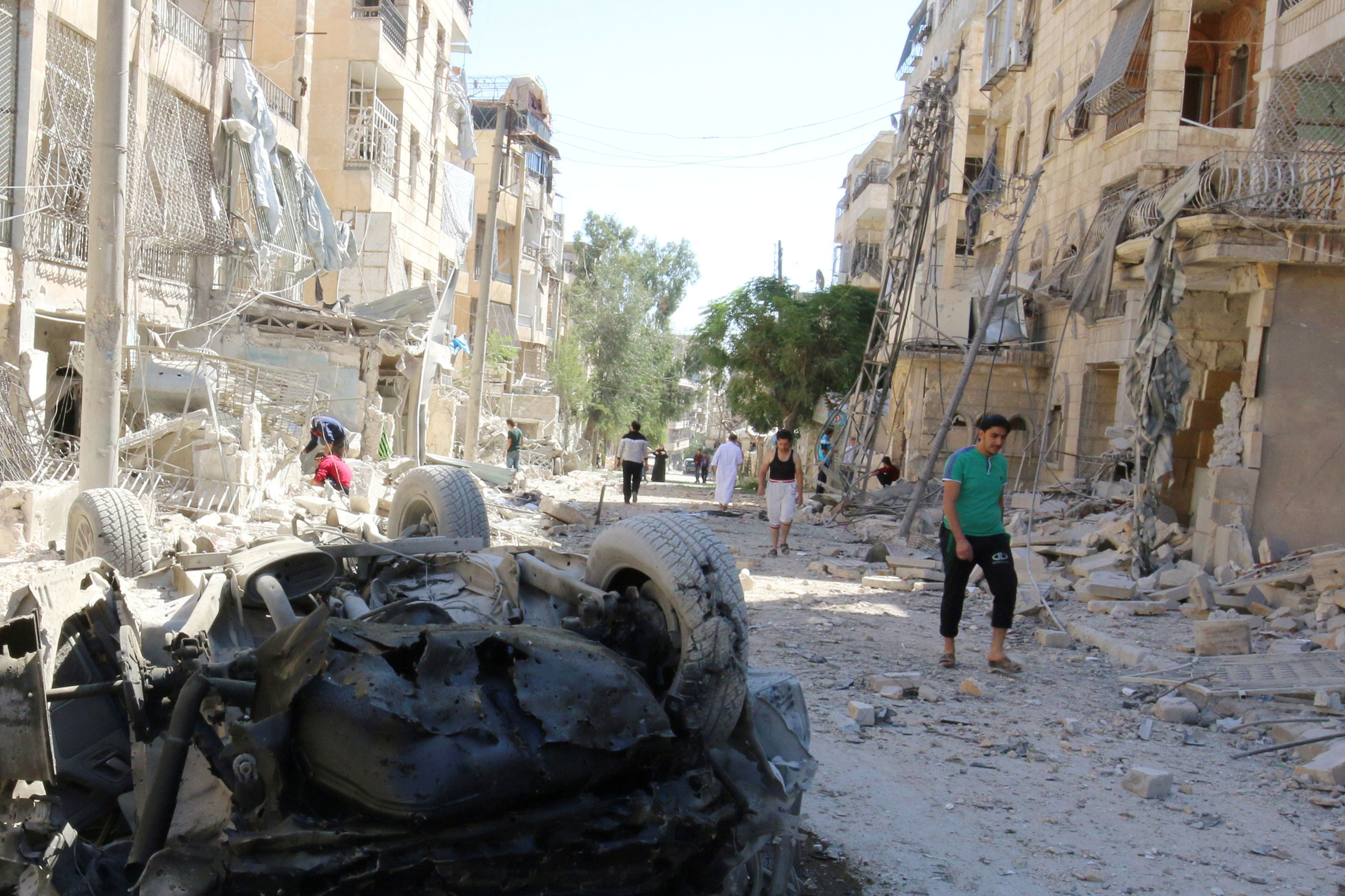 Survivors after an airstrike in the Seif al-Dawla neighborhood of Aleppo in Syria last week.