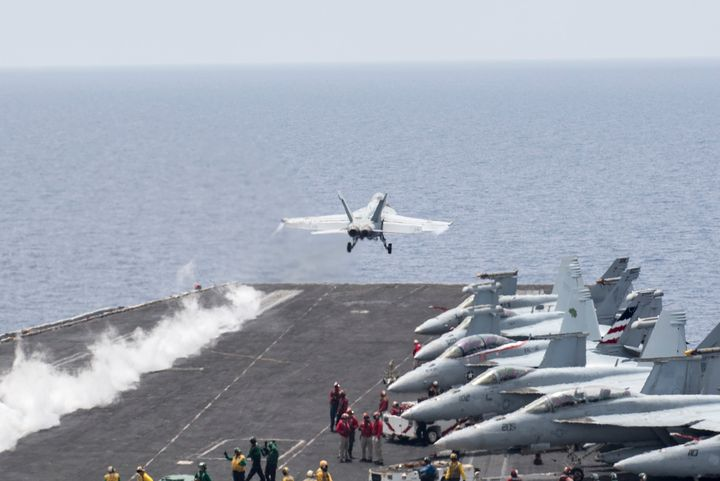 A U.S. FA/A-18 Super Hornet takes off from the deck of the carrier Harry&nbsp;<br>S. Truman to strike targets in the Middle E
