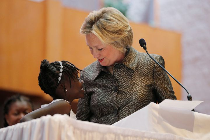 Nine-year-old Zianna Oliphant joins U.S. Democratic presidential nominee Hillary Clinton at the pulpit at the Little Rock AME